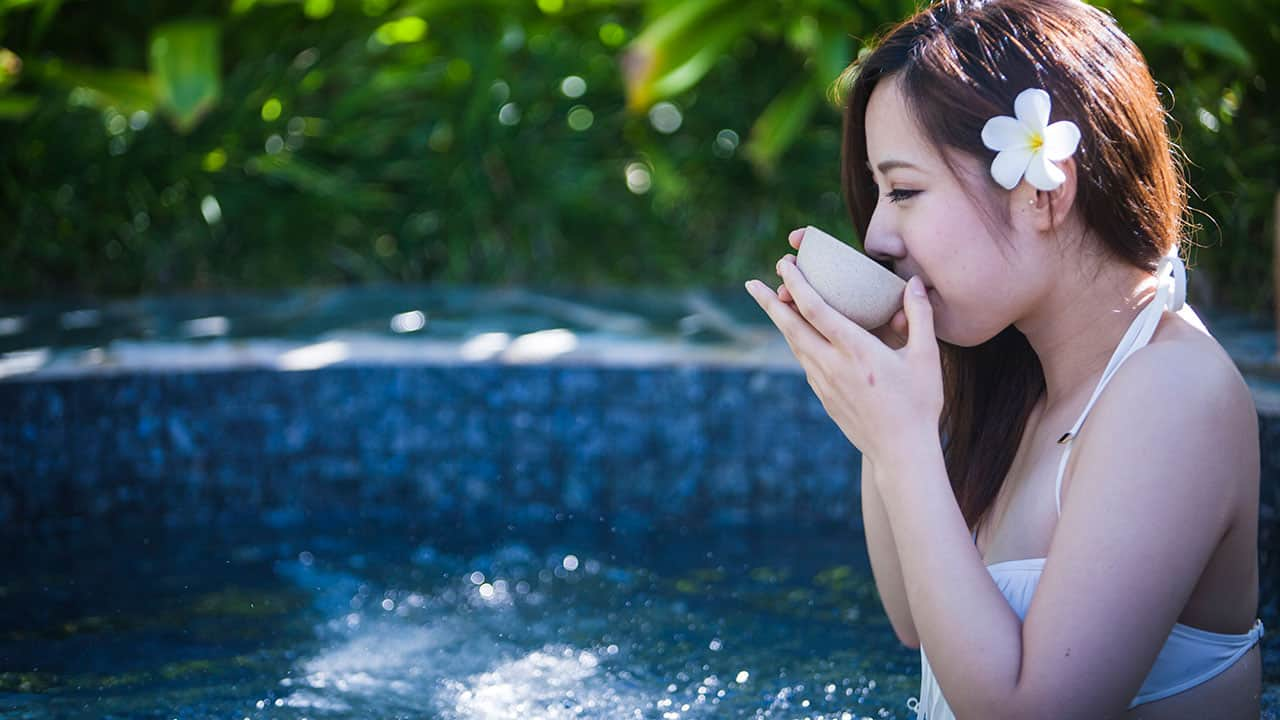 girl drinking tea in jacuzzi